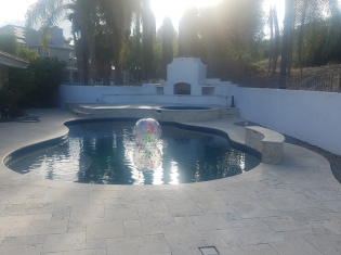 Freeform Pool with Raised Spa and Outdoor Living Area