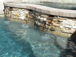 Raised Spa with Water Feature Wall