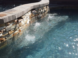 Remodeled Raised Spa with Water Feature Wall